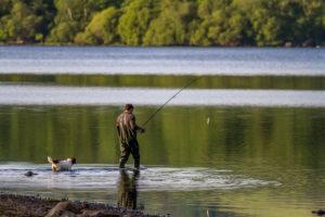 E22DY1 Fly fishing on Bassenthwaite Lake, English Lake District